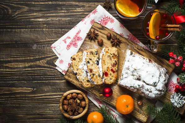 Stollen traditional Christmas ftuitcake with dried fruit and nut - Stock Photo - Images
