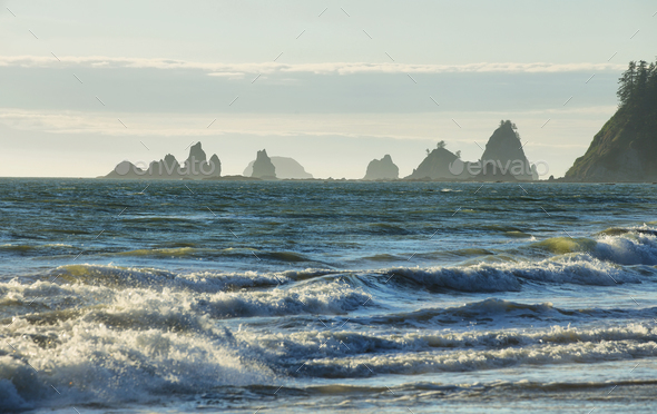 View of rocks in the ocean from Rialto beach - Stock Photo - Images