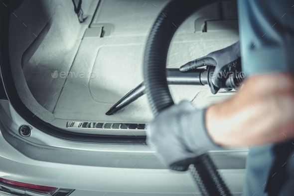 Men Vacuuming His Car - Stock Photo - Images