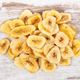 Dried organic banana chips on rustic board - PhotoDune Item for Sale