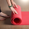 Female hands unrolling yoga mat before workout exercise. Healthy - PhotoDune Item for Sale