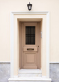 Wooden entrance door, beige color wall background, residential building in old town of Plaka - PhotoDune Item for Sale