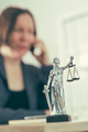 Attorney woman talking on mobile phone from her office desk - PhotoDune Item for Sale