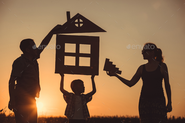 Happy family standing on the field at the sunset time. - Stock Photo - Images