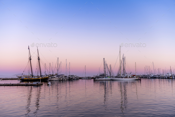 Sailboats in bay at sunset - Stock Photo - Images