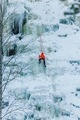 Athletic man in climbing a large blue wall of ice in Finland - PhotoDune Item for Sale