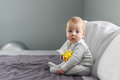 Sitting baby boy on grey carpet closeup - PhotoDune Item for Sale