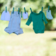 Baby clothes on clothesline in garden - PhotoDune Item for Sale
