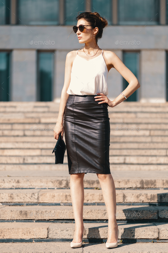 1d99d18795de Fashionable brunette businesswoman in leather pencil skirt and s - Stock  Photo - Images