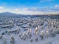 Aerial view of snow covered winter forest and road. Beautiful rural landscape in Finland - PhotoDune Item for Sale