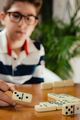 Boy playing dominoes - PhotoDune Item for Sale