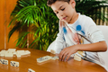 School boy playing dominoes - PhotoDune Item for Sale