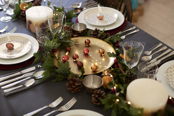 Christmas table setting with bauble name card holders arranged on plates - Stock Photo - Images