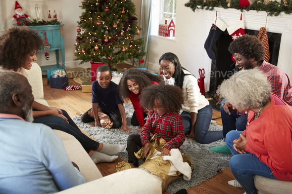 Son Opening Gift As Multi Generation Family Celebrate Christmas At Home Together - Stock Photo - Images