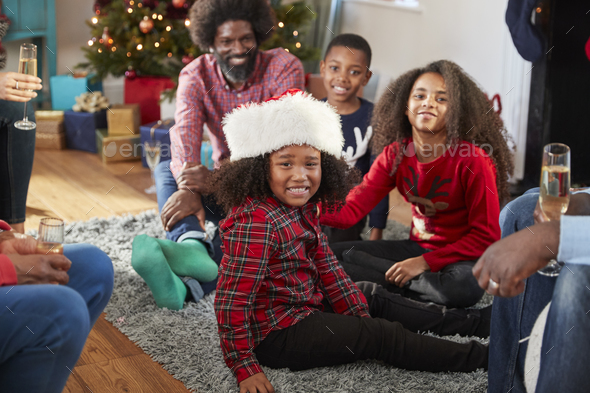 Portrait Of Boy Wearing Santa Hat As Multi Generation Family Celebrate Christmas At Home Together - Stock Photo - Images
