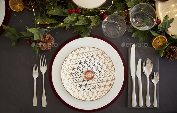 Christmas table place setting with bauble arranged on a plate  - Stock Photo - Images