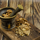 Walnuts in a metal mortar with pestle - PhotoDune Item for Sale