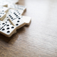 Domino Game, Dominoes On Wooden Table - PhotoDune Item for Sale