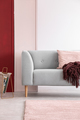 Newspaper rack next to grey couch in bright living room interior - PhotoDune Item for Sale