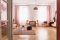 Pale pink living room interior in tenement house, real photo wit - PhotoDune Item for Sale