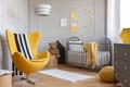 Yellow armchair, teddy bear and crib in a modern kid room interi - PhotoDune Item for Sale