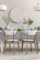 Two white chairs standing by the table with fresh plants and gla - PhotoDune Item for Sale