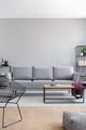 Real photo of a simple living room interior with a grey sofa, ar - PhotoDune Item for Sale
