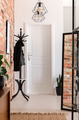 White and brick walled entrance hall interior in real photo with - PhotoDune Item for Sale