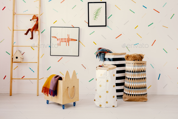 Wooden crate and patterned bags in child's room interior with fo - Stock Photo - Images