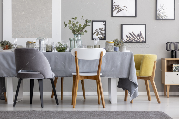 Modern Chairs At Table With Tableware In Grey Dining Room Interi
