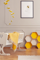 Cot with a blanket and yellow honeycombs in a kid room interior. - PhotoDune Item for Sale
