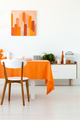 White wooden chair at table with orange cloth in dining room int - PhotoDune Item for Sale