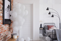 Poster on red brick wall and balloons in bedroom interior with b - PhotoDune Item for Sale