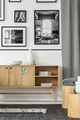 Gallery above wooden cupboard in bright apartment interior with - PhotoDune Item for Sale