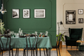 Black and white posters on green wall of stylish dining room int - PhotoDune Item for Sale