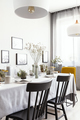 Black chairs at table with tableware in bright dining room inter - PhotoDune Item for Sale