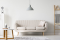 Grey lamp above pillow on white sofa next to wooden coffee table - PhotoDune Item for Sale