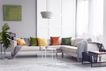 Lamp above table next to corner sofa with pillows in apartment i - PhotoDune Item for Sale