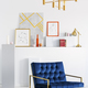 Gold lamp above blue armchair in white living room interior with - PhotoDune Item for Sale