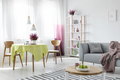 Living and dining room in modern apartment with grey couch and w - PhotoDune Item for Sale