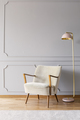 Real photo of pastel pink metal lamp standing by the white armch - PhotoDune Item for Sale
