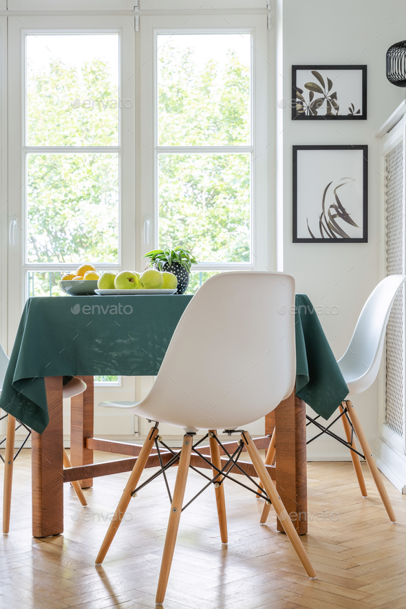 Vertical View Of Stylish White Chair Next To Kitchen Table With