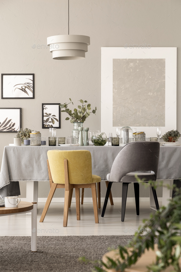 Grey And Yellow Chair At Table Under Lamp In Dining Room Interio