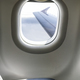 Plane interior sit and window. Airplane wing seen through the wi - PhotoDune Item for Sale
