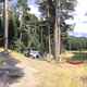 Panoramic image of forest and mountain lake. Tents and car in th - PhotoDune Item for Sale