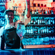 Glass of fiery cocktail on the bar counter against the background of bartenders hands with fire - PhotoDune Item for Sale