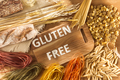 Gluten free food. Various pasta, bread and snacks on wooden background from top view - PhotoDune Item for Sale