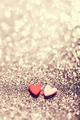 Two hearts on glittery sparkly background. - PhotoDune Item for Sale