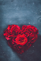 Heart-shaped rose bouquet on stone background. - PhotoDune Item for Sale
