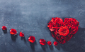 Heart-shaped red roses on stone background. - PhotoDune Item for Sale